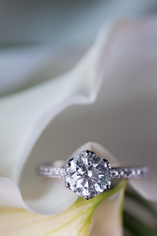 Bride's Engagement Ring photographed using a groomsman's boutineer during the reception dinner.