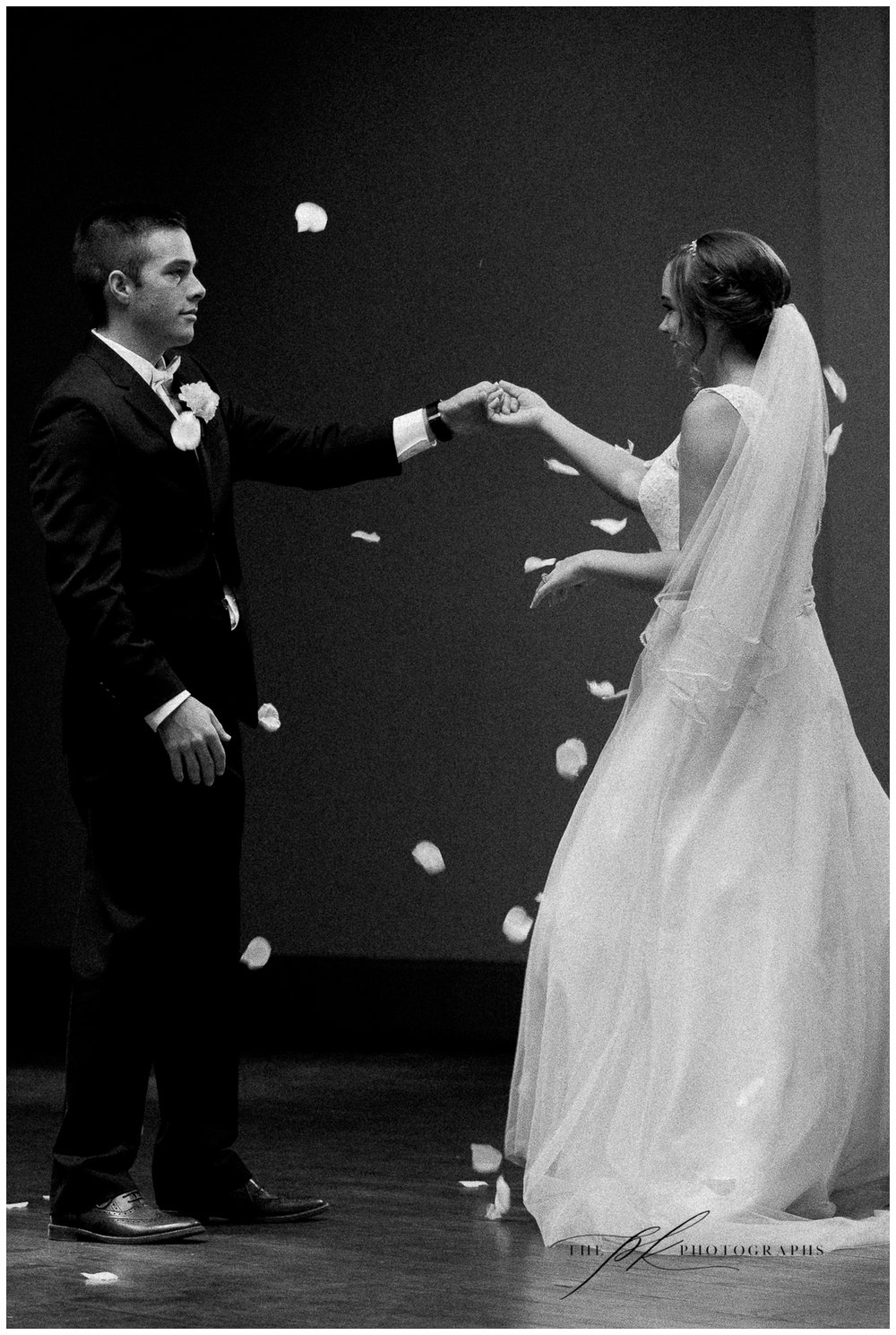 During the ceremony I noticed a gorgeous pocket of light (yes I know how crazy that sounds, but there was a skylight!) so right after the ceremony I scooped up a handful of the flower petals from the wedding aisle and had Adam twirl Allison while the petals fell.