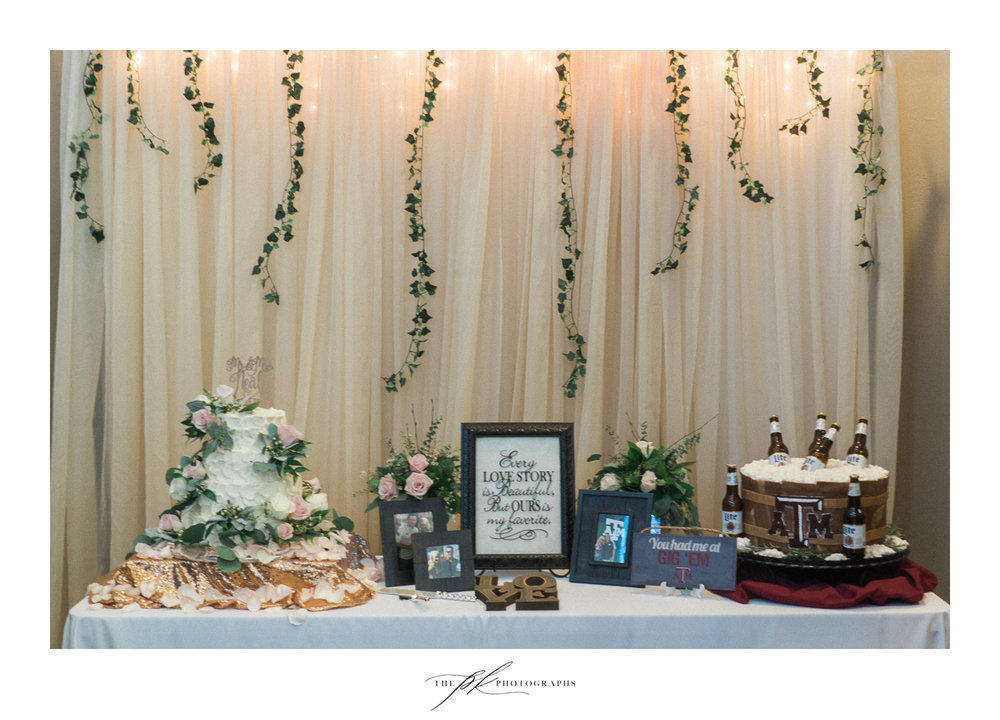 The cake table was beautifully decorated, with ivy and engagement photographs, and of course two beautiful cakes!  The Lodge At Country Inn Cottages | San Antonio Wedding Photographer
