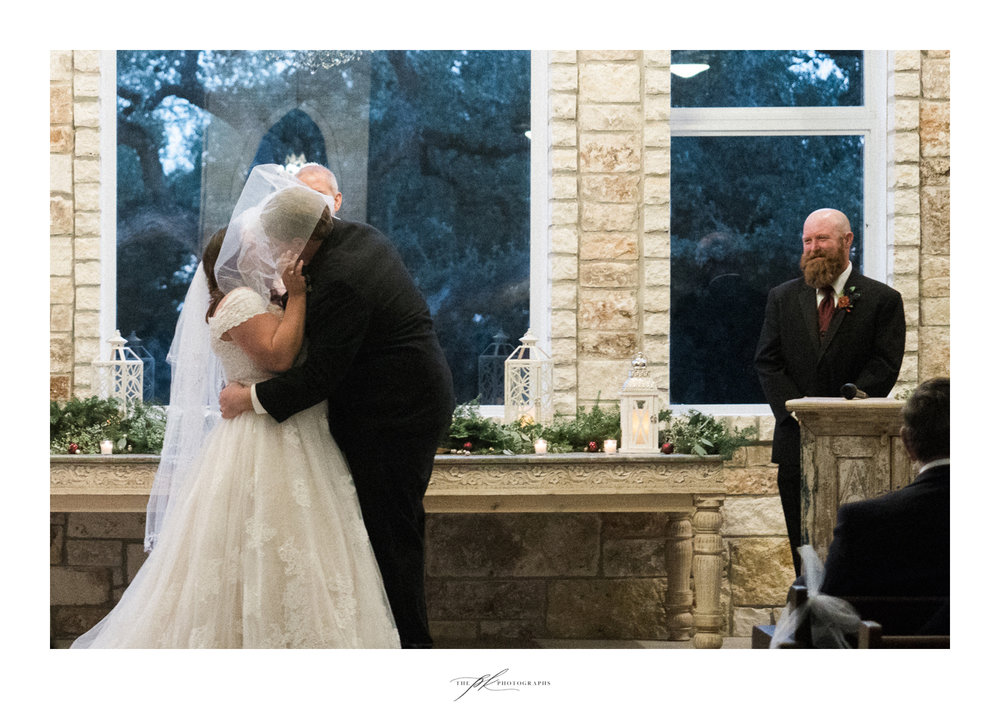 Emily and Lamar's second kiss as husband and wife during their wedding ceremony in the open air chapel at the Chandelier of Gruene