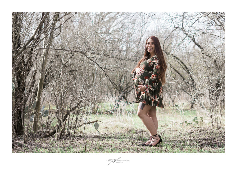 Andrea in a green, floral print dress during her maternity photoshoot in San Antonio, Texas.