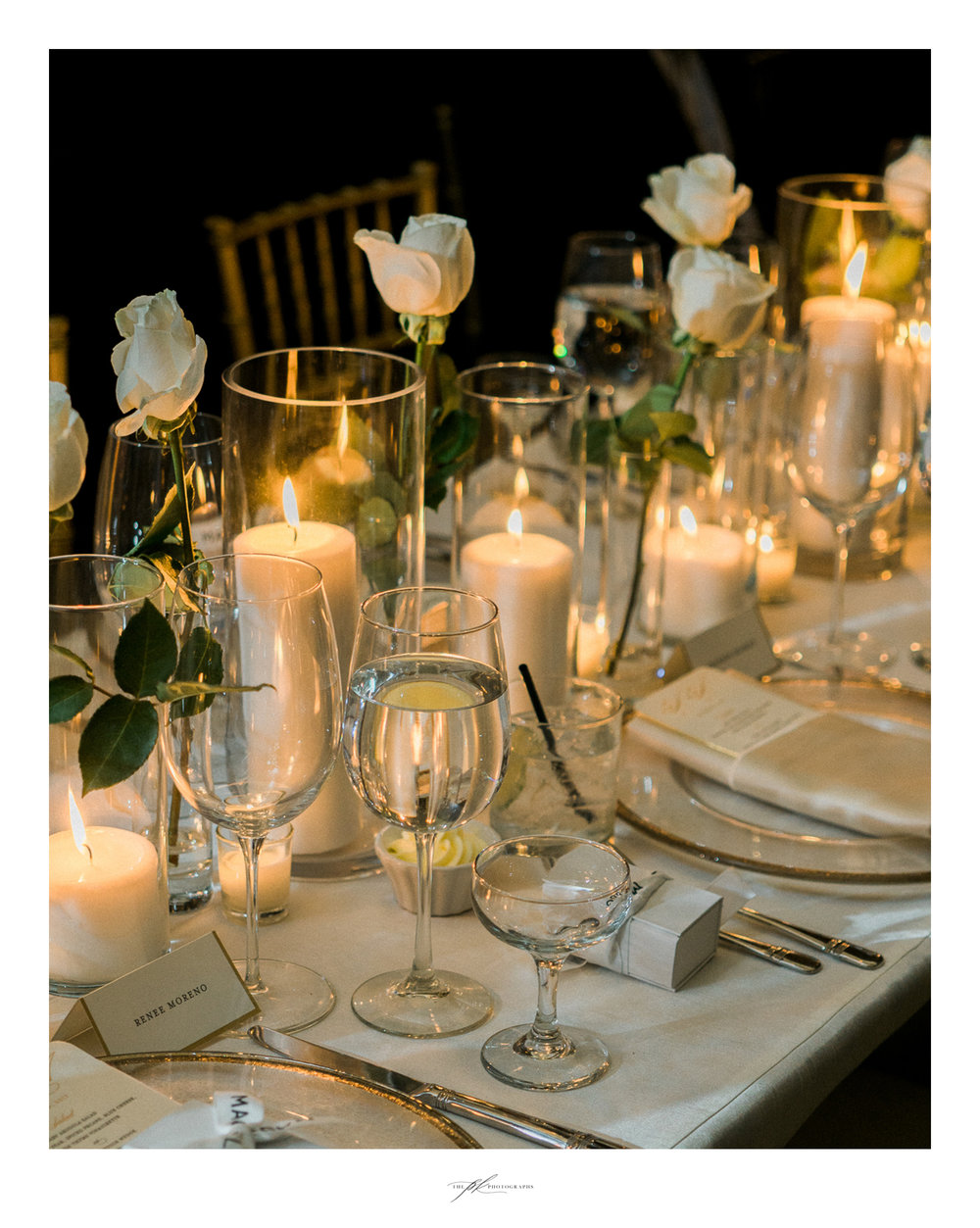 White rose and gold accent wedding reception decor.
