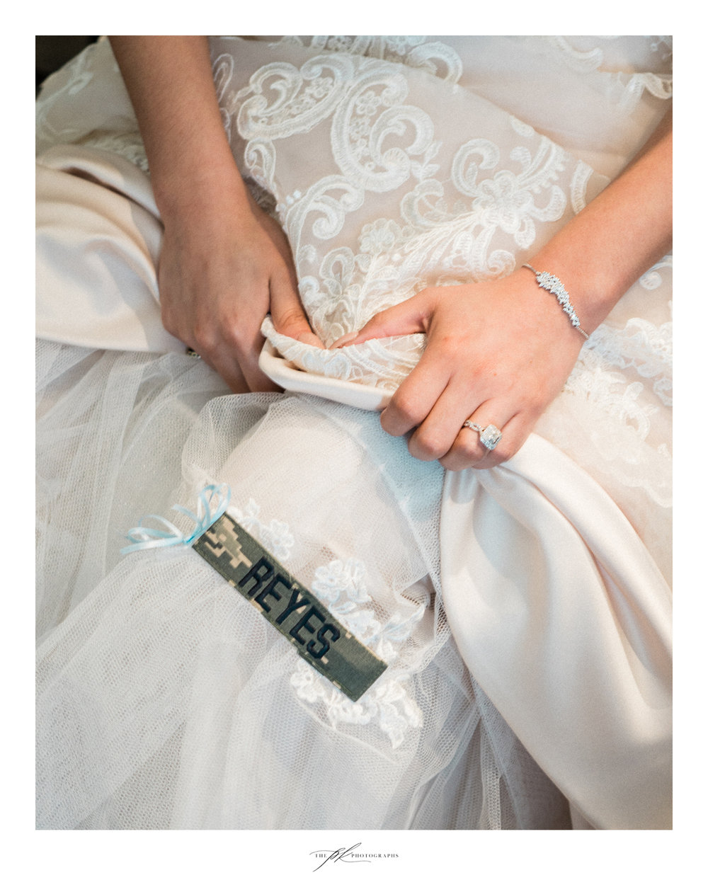 Bride's father's Air Force name badge sewn into her wedding dress at Magnolia Halle in San Antonio, Texas - Photographed by The PK Photographs