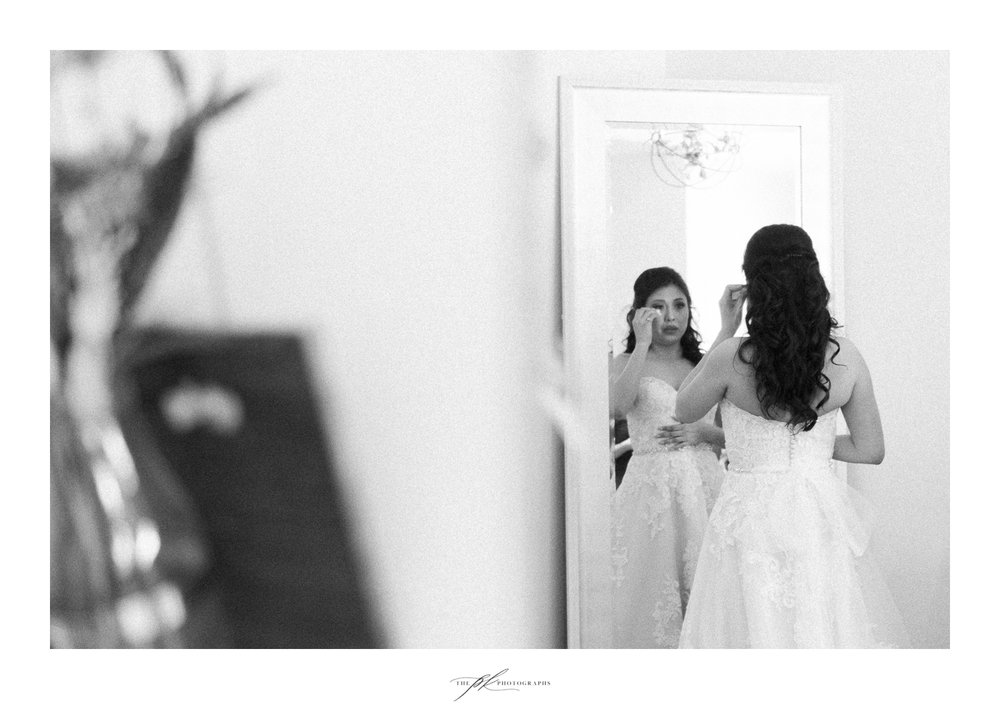 Bride getting ready for her wedding ceremony at Magnolia Halle in San Antonio, Texas - Photographed by The PK Photographs