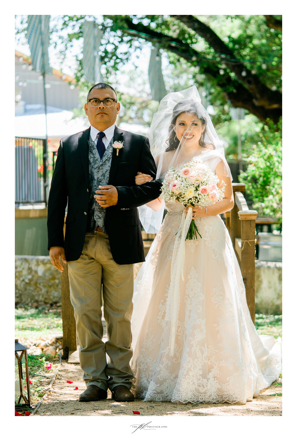 Bride and her father during their wedding ceremony at Magnolia Halle in San Antonio, Texas - Photographed by The PK Photographs