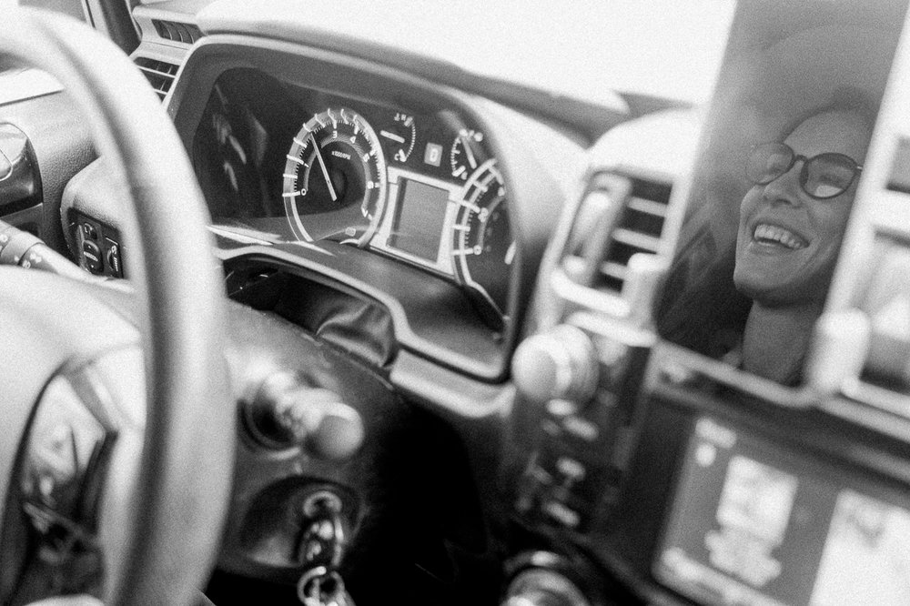 This is one of those moments where I saw this photo with my eye (reflection of May's face in her phone, and her dashboard and steering wheel in the frame) and quickly grabbed my camera to grab this photo.  Captured by Parker on digital | 35mm