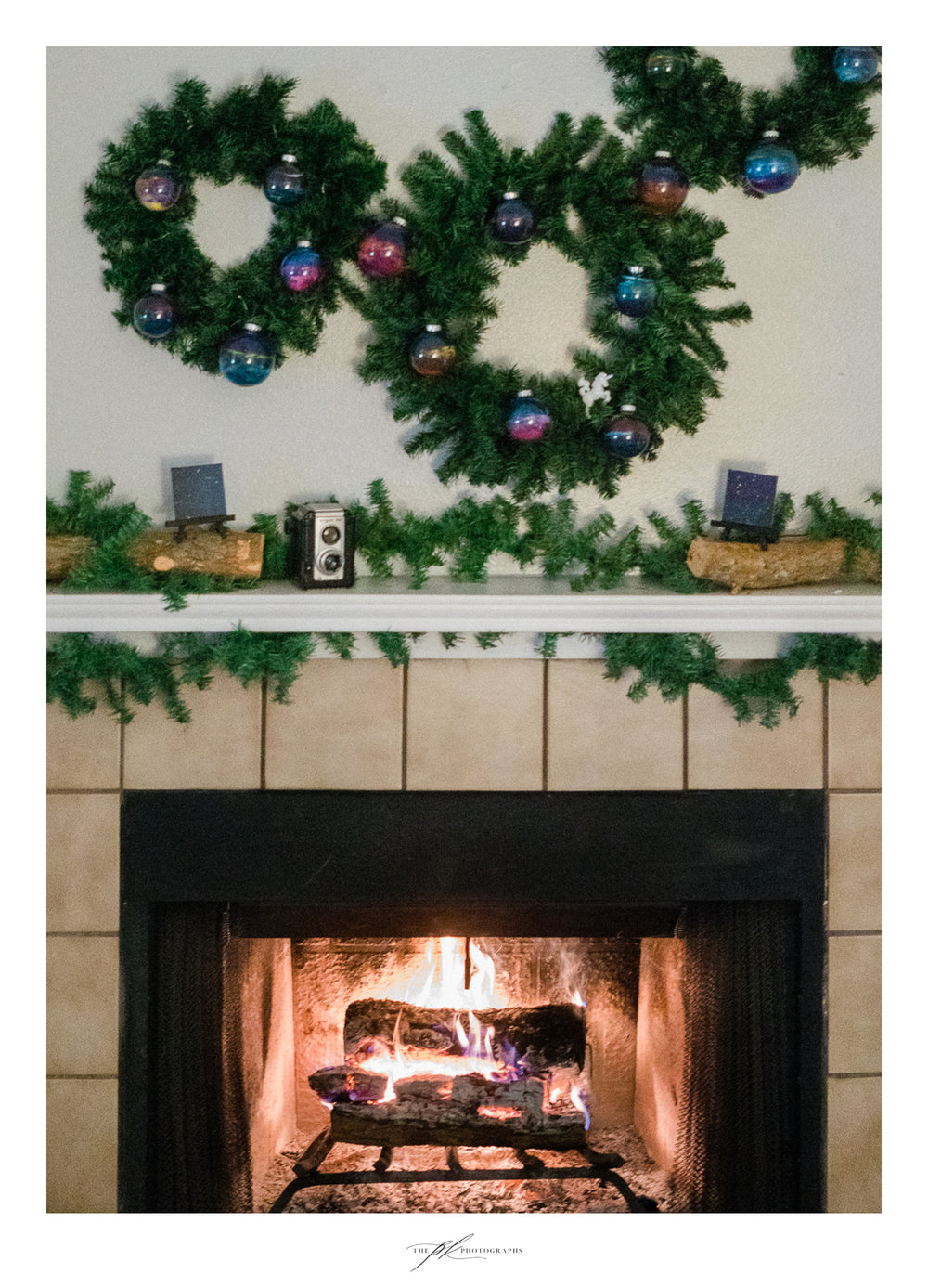 Fireplace decorated for the holiday season.