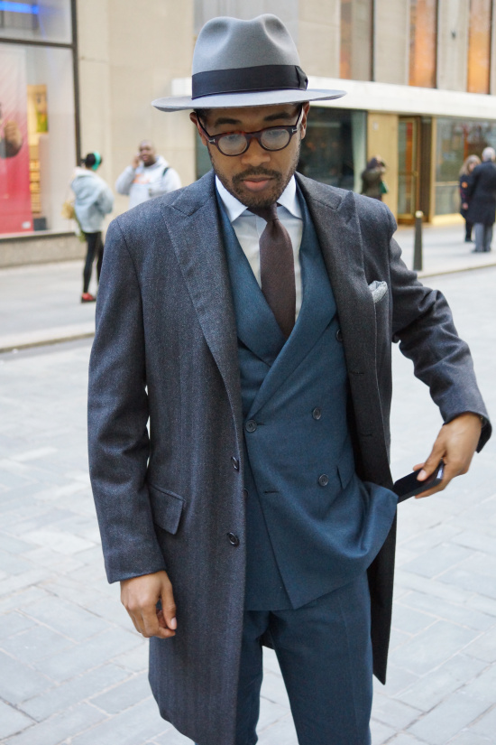 Coat and suit by Brioni, shirt by Piatelli, tie by Isaia, hat by Selentino, eyeglass frames by Tom Ford