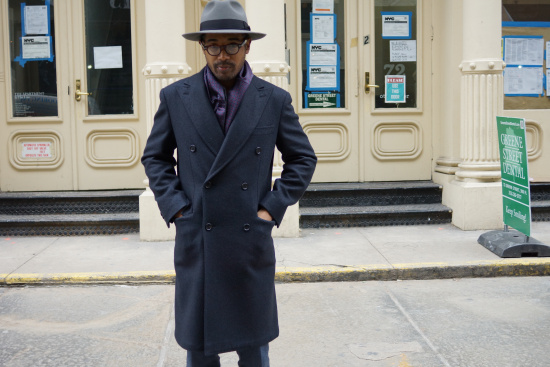 Hat by Selentino, coat and scarf by Brioni, trousers by Gant