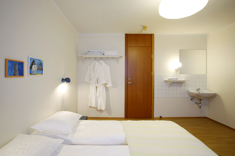 Double room. Every room includes a wash station. We supply slippers and robes to all our guests so you can walk the halls comfortably.