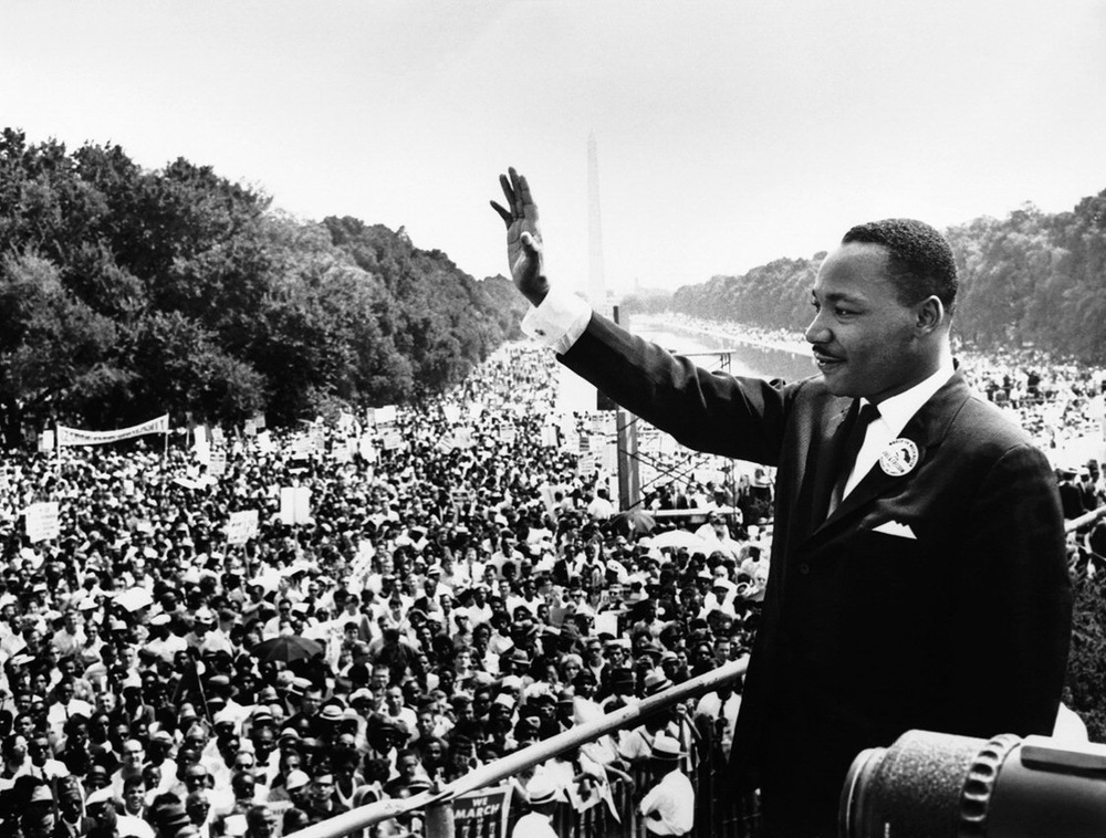 "In this August 28, 1963 file photo, Dr. Martin Luther King Jr. acknowledges the crowd at the Lincoln Memorial for his ""I Have a Dream"" speech during the March on Washington. (AP Photo/File)"