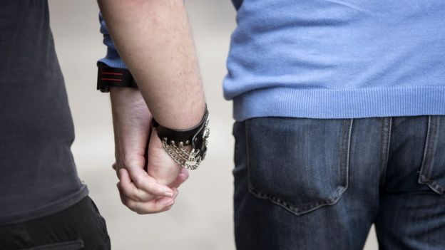 LGBT hand holding?!?!?!.jpg