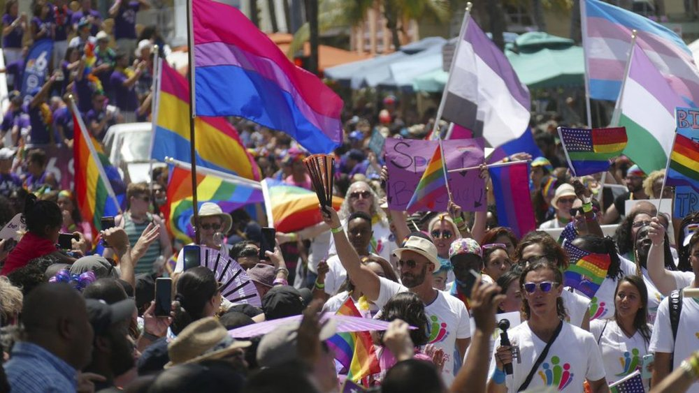People march during the 2017 Miami Beach Gay Pride parade on April 9. (Emily Michot/Miami Herald/AP)