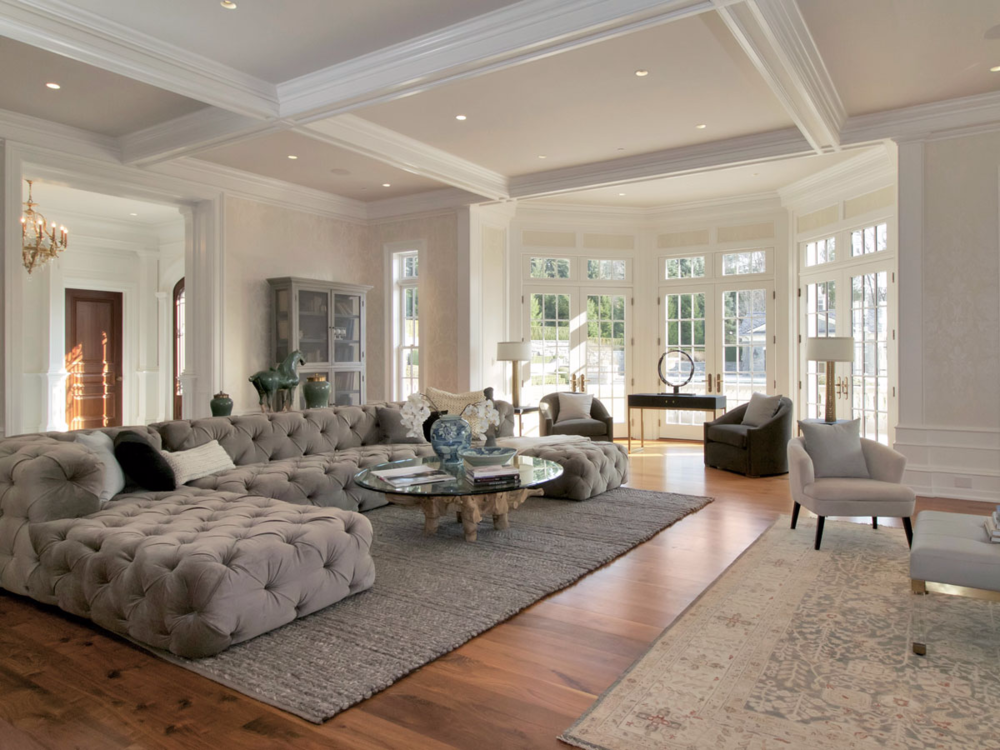 the-focal-point-of-the-living-room-is-this-large-low-back-sofa-and-coffee-table-and-a-small-area-near-the-fireplace.jpg