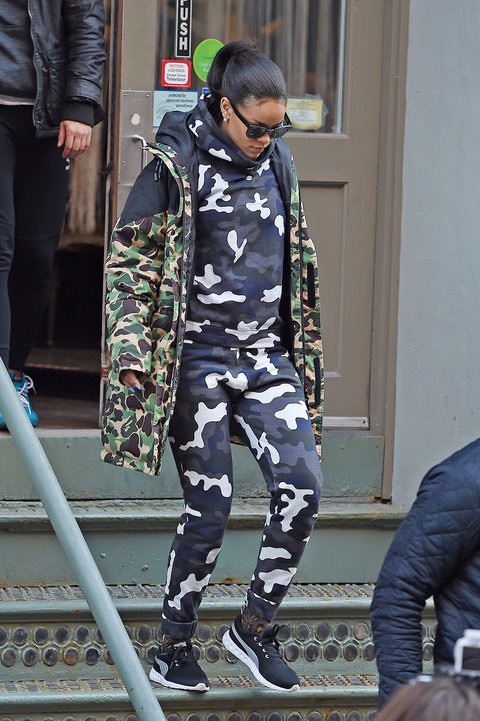 Riri rockin' a camo coat from the Puma x A Bathing Ape collab.