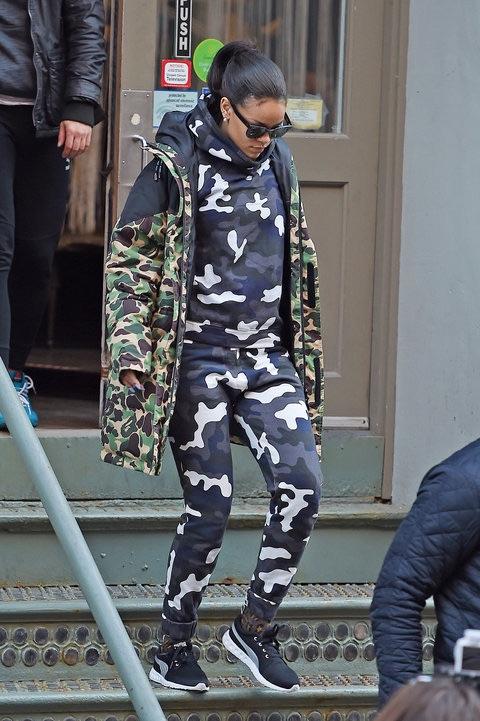 Riri rockin' a camo coat from the Puma x A Bathing Ape collab.