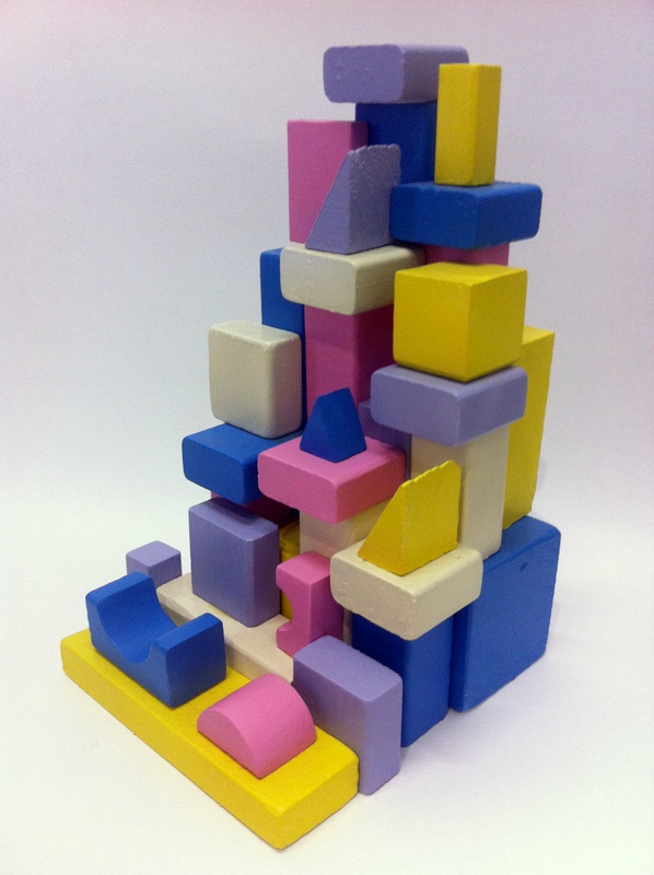 Abstract sculpture in yellow pink purple and blue