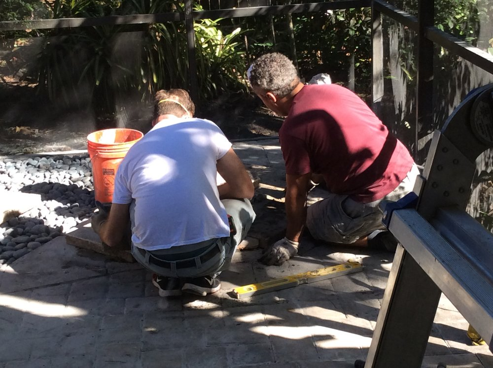 Benedito and I setting flagstones in mortar