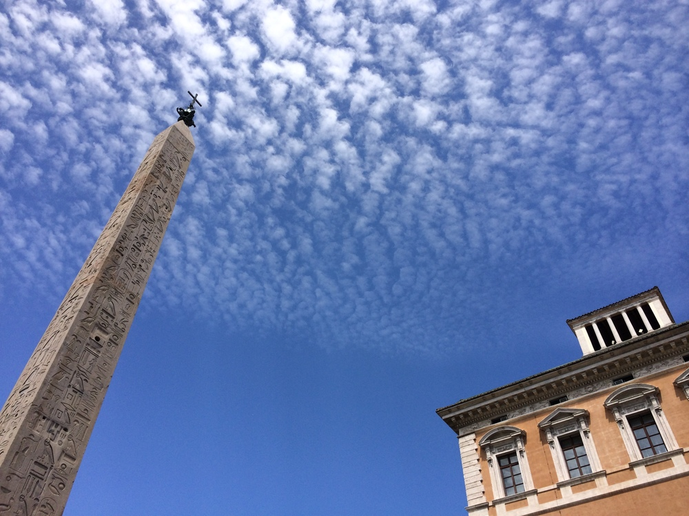The sky outside of one of Italy's many churches.