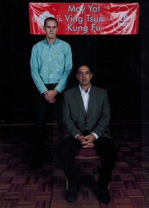 Sifu Brad Schonhorst (left) with his Sifu, Sigung Moy Yat Tung (seated).