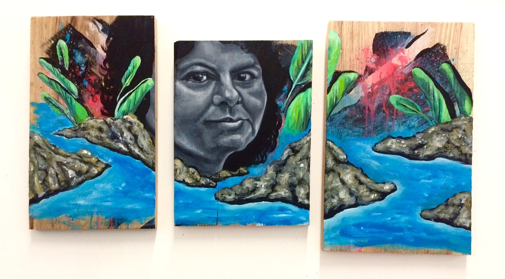 Portrait tribute to Berta Cáceres, late Honduran environmental activist who was assassinated in early March 2016. Her life's work was protecting the Lenca people and their sacred river from corporate exploitation. Her physical body may be gone, but her resolve will never go away.  Triptych, acrylic on wood, March 2016.