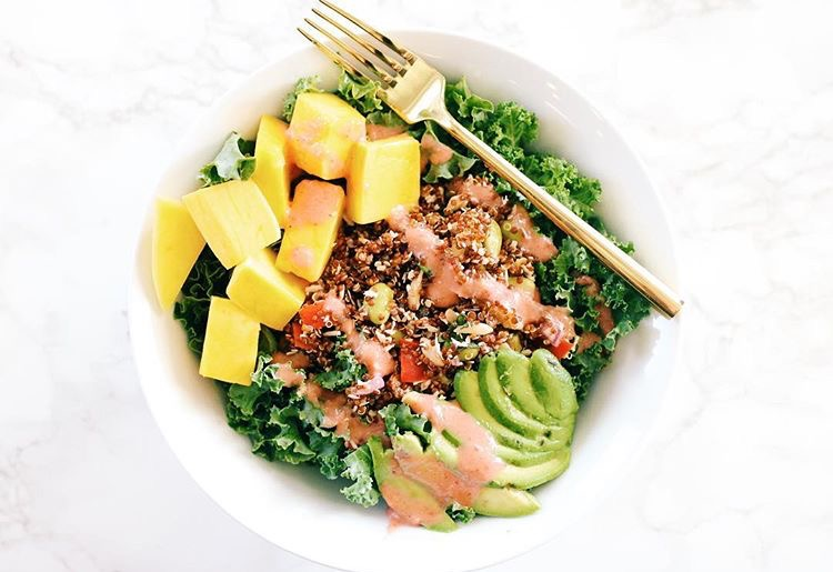 Pictured: organic kale salad topped red quinoa, soy beans, mangoes, avocados, and homemade strawberry vinaigrette (recipe at: https://www.instagram.com/p/BLeTFJoB-Nc/)