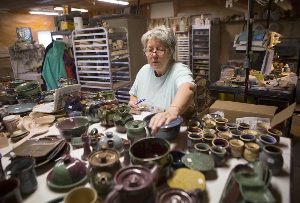 Susan Sherman sorts her pottery in her studio in Amesville. Sherman makes pieces using clay from Ohio for her business, Marietta Run Clay.