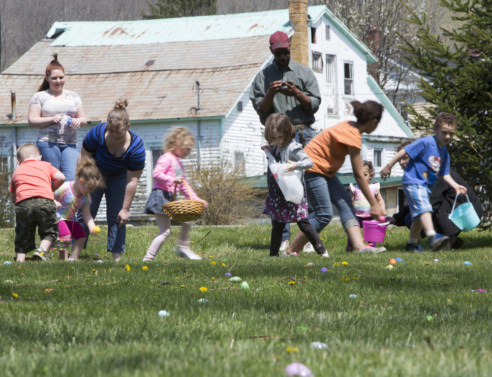 Children scramble for eggs in Gifford Park the day before Easter for the 8th annual Easter egg hunt. Amesville resident Samantha Gates began organizing the hunt eight years ago, because she wanted an egg hunt event closer to home for her children instead of traveling to Athens.