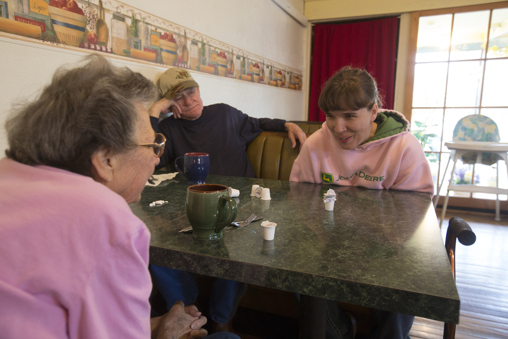 """From left, Mary Carpenter and her husband Darrell """"Sonny"""" Carpenter from Chesterhill, Ohio, visit with waitress Katie Kerns in Kasler's Country Kitchen. Mary used to work as a dishwasher in the kitchen until she had to stop working due to an illness."""