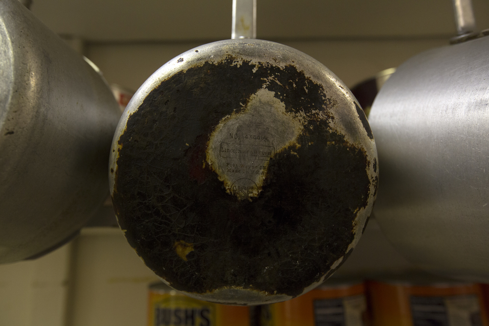 Worn pots and pans hang in the kitchen at Kasler's Country Kitchen in Amesville.