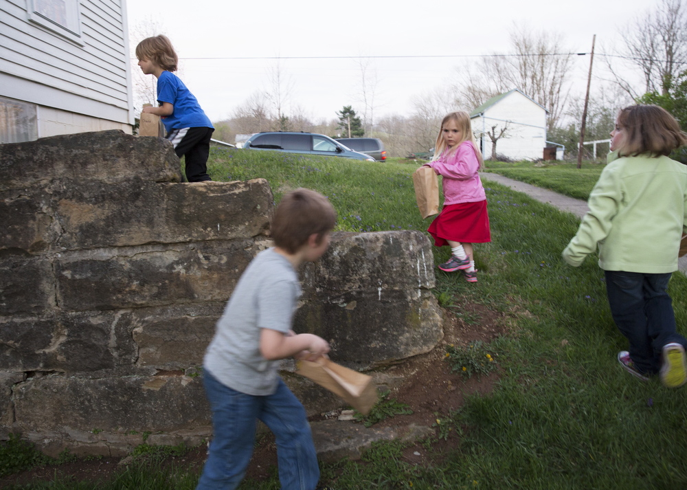 From left, Chase Smalling, 7, Andrew Zimmerman, 6, Vanessa Harris, 4, and Kaylee Ford, 5, hunt for eggs outside the Amesville Presbyterian Church during the parish lock-in.