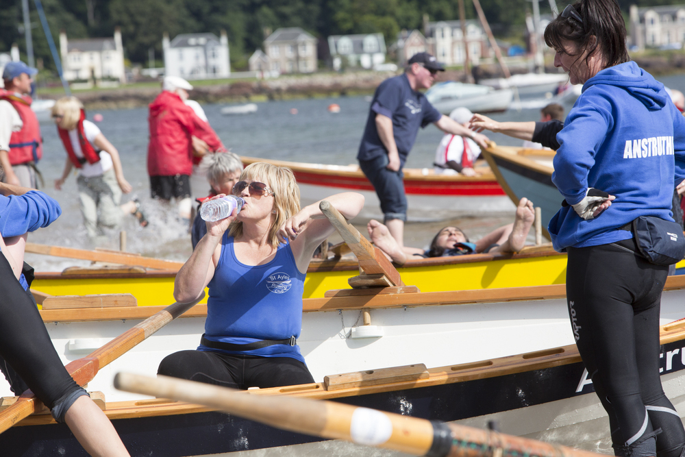 Elsie Johnstone takes a rest with her Anstruther teammates after competing in the long race of the Sail and Oar event on Cumbrae.