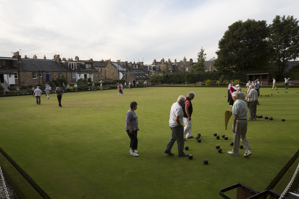 Members of the Blackhall Bowling Club participate in the weekly Monday evening hat night at the lawn bowling club in Edinburgh.