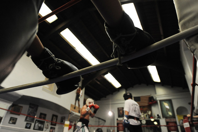 Boxers wait around the ring at the center of La Habra Boxing Gym in La Habra, Calif. Saturday, April 10, 2010.