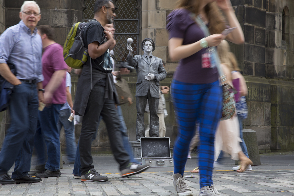 John Godbolt, from Bristol, England, stands in front of St. Giles Cathedral on the Royal Mile during the 2014 Edinburgh Festival of the Fringe in Edinburgh, Scotland.