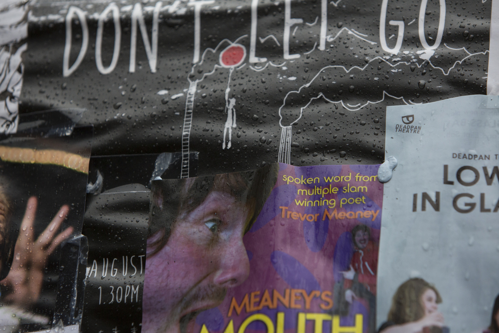 Rain hits posters during the 2014 Edinburgh Festival of the Fringe in Edinburgh, Scotland.