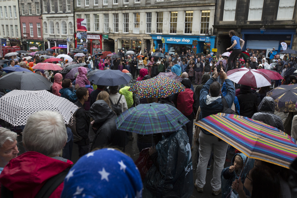 People walk through the rain during the 2014 Edinburgh Festival of the Fringe in Edinburgh, Scotland.