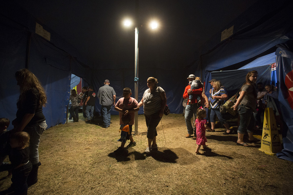 Customers walk through the exit of the Kelly Miller Circus after the end of anothe show.