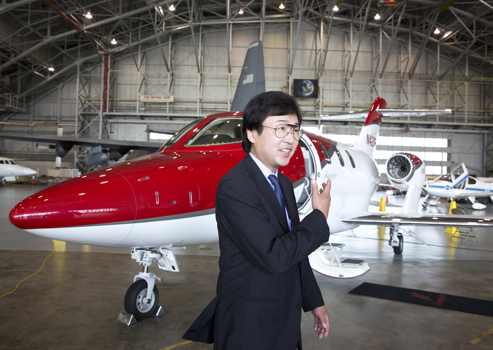 Honda Aircraft President and CEO Michimasa Fujino talks to others outside the HondaJet at NASA's Langley Research Center Tuesday, July 12, 2016. Copyright: The Daily Press