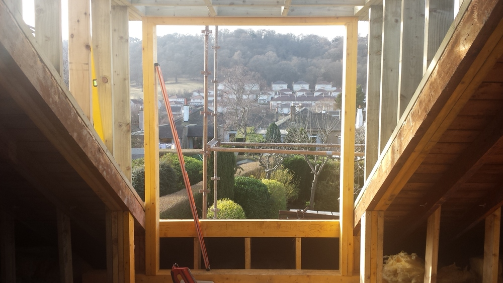 New dormer window formed to the rear of a 1930's bungalow in Blackhall, Edinburgh. Lovely view of Hillpark Woods beyond.