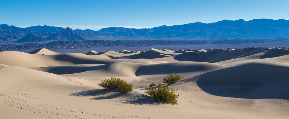 Wind shaped sand dunes at Death Valley.jpg