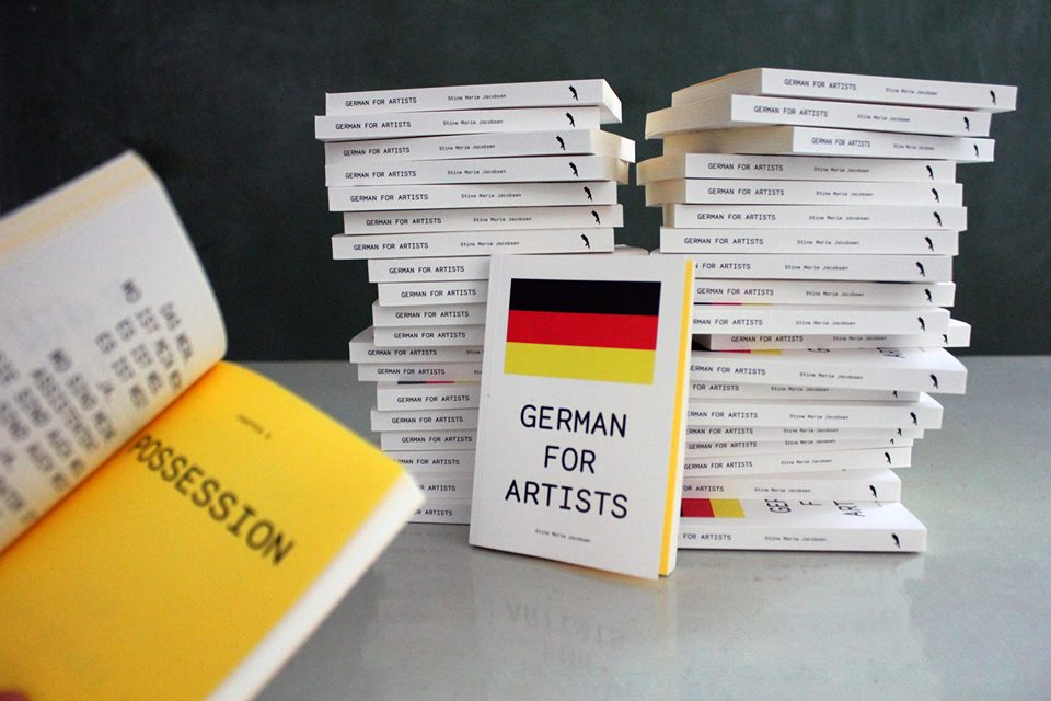 "GERMAN FOR ARTISTS    Concept: Stine Marie Jacobsen    Editor: Ida Bencke Graphic    Design: Pieterjan Grandry /modem.ws   Soft cover   Pages 174    ISBN: 978-3-943196-31-3    September 2015. ENGLISH/GERMAN   German for Artists   is a hybrid pocket grammar book and an artist's humorous reflections on the more philosophical aspects of the German language. Written by the Danish artist Stine Marie Jacobsen, the book offers a critical and very humorous linguistic introduction to the vibrant and international cultural scene in Berlin. The book looks at contemporary art through the optics of language teaching, educates the reader about art and German grammar at one and the same time.  German for Artists offers an insight into the basic German grammar by using well-known people on the international art scene to visualise the rules. The book is designed for artists, curators and other art enthusiasts who dream of learning German. It is an easily portable book offering grammatical first aid and ready-to-use phrases, that will help your understanding of the language in the German art world. A must for all ""nicht-so-gut-deutsch"" - speaking cultural workers in Germany's capital! The book offers advice to help art people in different typical social and practical situations in the Berlin art world.  Stine Marie Jacobsen   (b. 1977), is a conceptual artist working to decode individual and collective violence through participatory means. Focusing on language, gender and psychology, she uses film as a starting point to create performative experiments and platforms for new ways of looking at ethics, identity, fear and trust. She lives and works in Copenhagen and Berlin, graduated from the Royal Danish Academy of Fine Arts with an MFA and a BFA from CalArts, the California Institute of the Arts, Los Angeles, USA.   Some of her notable solo shows have been at Künstlerhaus Bethanien, 2012, Berlin, Kohinoor, 2010, Copenhagen, District Kunst- und Kulturförderung, 2014, Berlin, Galway Arts Center, 2014, Galway, Ireland and Overgaden institute of contemporary art, 2015, Copenhagen, Denmark. Selected group shows consist of Six Impossible Things Before Breakfast, Momentum Biennale 2013, Moss, Norway, Either Or Nikolaj Kunsthal, 2013, Copenhagen, Idyll Turku Biennale, Turku, Finland, The 10th OPEN International Performance Festival, 2009, Beijing.   In order to give participants a collaborative and dialogical space, Stine creates open structured sociocultural and participatory projects with clearly defined themes. With a focus in themes such as film, language, gender, violence, death, taboos, anonymity, psychology, the artist conducts performative experiments and creates platforms for critical thinking and new ways of looking at ethics, identity, control, fear and trust.   Over the years Stine has conceptualised and worked on a number of participatory projects that are within these parameters, like for example Direct Approach, where participants are asked to retell their most violent film scene memory and choose whether they would play victim, perpetrator or bystander and why. Stine has organised and facilitated many  Direct Approach  workshops in Germany, Ireland, Colombia and Denmark. In 2014 the project was a 6 month workshop at District Kunst- und Kulturförderung in Berlin in collaboration with social work organisations Gangway and Streetcollege and was jury selected for Berlin Art Week.   Another example is Mann beißt Hund (a remake of the Belgian film C'est arrivé près de chez vous), without actors. Alongside the use of film as a law system, with lawyers the artist also organised court cases with teenagers, where real lawsuits were rejudged and in workshops rights in private and public space were reflected on and discussed.   In 2015, Stine was awarded an innovative educational grant from Node curatorial studies in Berlin and in 2016 she will receive a peace fellowship and professional Conflict Resolution certificate from the Rotary Club."