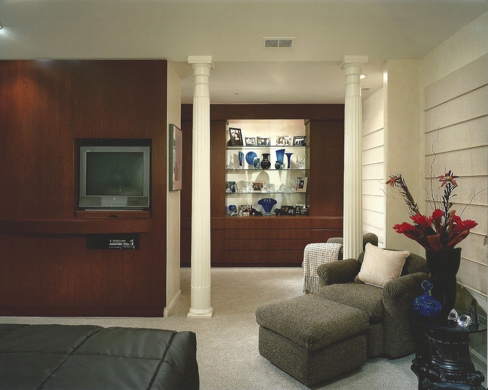 Master bedroom with custom built-ins for dressing room and TV