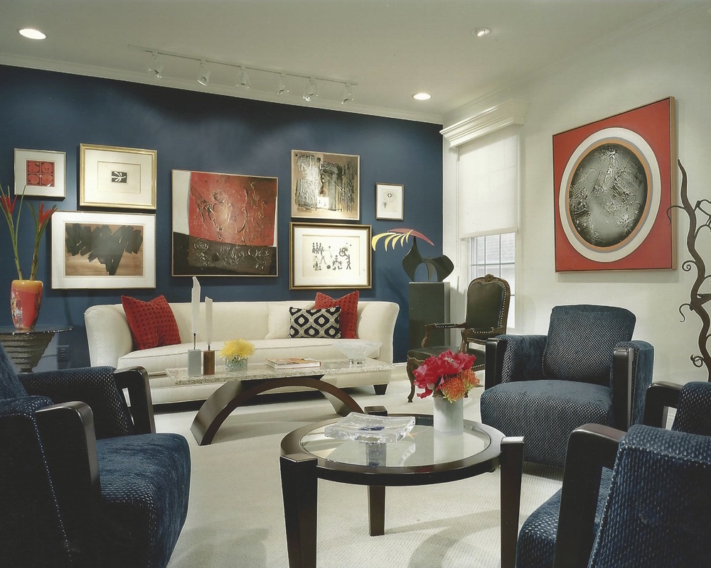 Living room with custom cocktail tables (designed by Cheryl Diamond) and client's art collection.