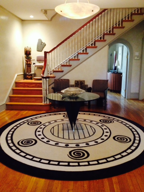 Home entrance with a custom rug and a stair lift installed