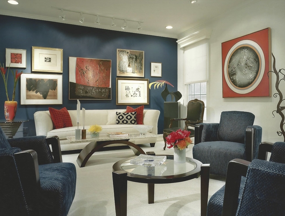 Living room with custom cocktail tables and art collection.