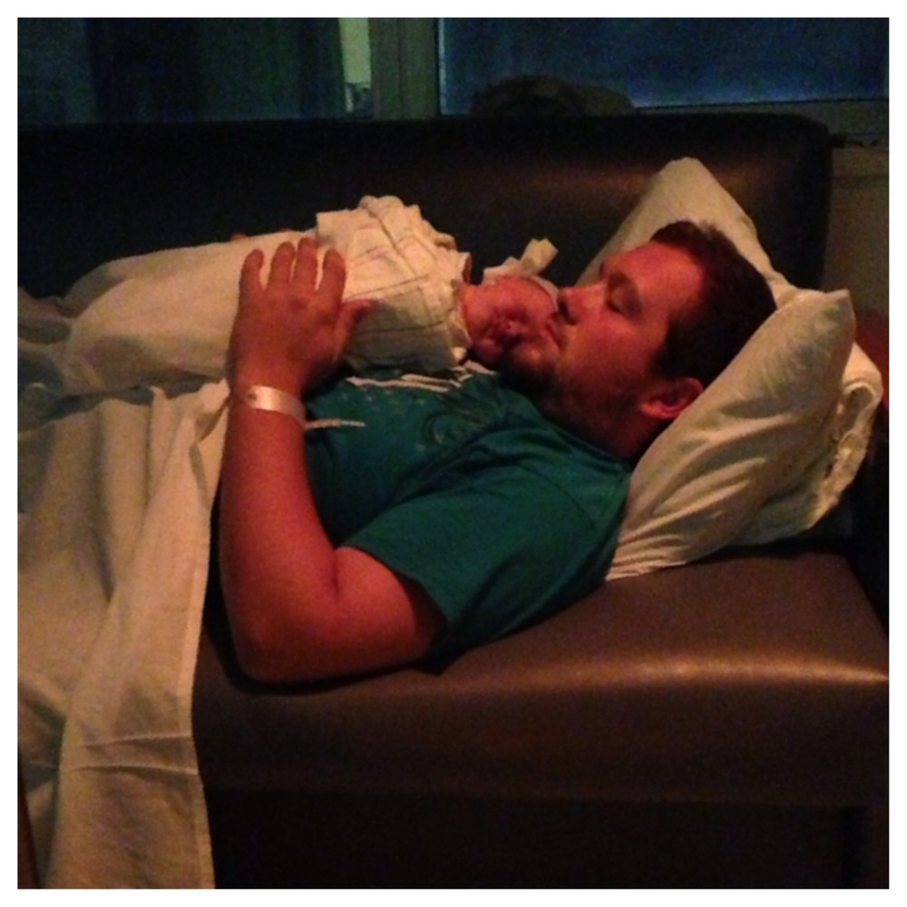 Dad relaxing with a newborn Genna Bell