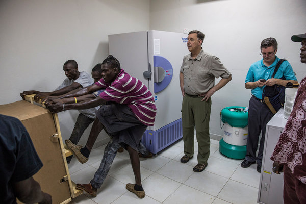orkers struggled to position a freezer designed to store an Ebola vaccine at a warehouse in Freetown, Sierra Leone. CreditBryan Denton for The New York Times