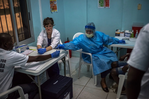 A nurse administered an injection of an Ebola vaccine last month as part of a study at Redemption Hospital, formerly an Ebola holding center, in Monrovia, Liberia.  CreditDaniel Berehulak for The New York Times