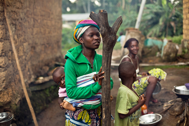 Women gather in the Guinean village of Meliandou, believed to be Ebola's ground zero.Jerome Delay/AP